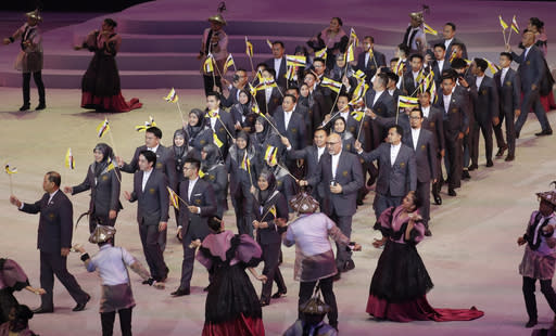 Brunei's team march during the opening ceremony of the 30th South East Asian Games at the Philippine Arena, Bulacan province, northern Philippines on Saturday, Nov. 30, 2019. (AP Photo/Aaron Favila)