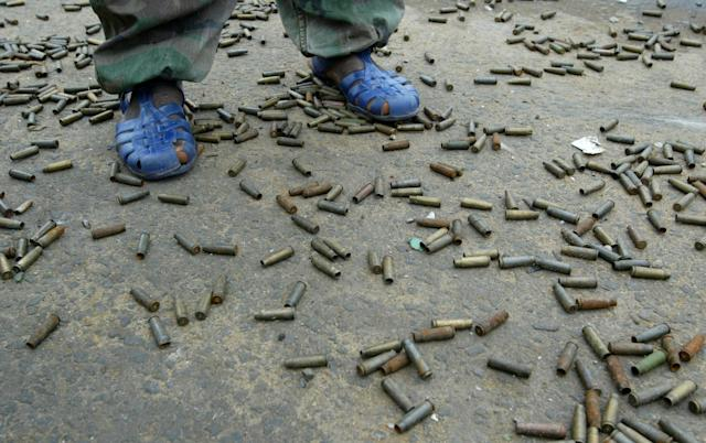<p>A Liberians United for Reconciliation and Democracy (LURD) stands among hundreds of shell casings August 6, 2003 in Monrovia, Liberia. LURD rebels still hold positions on the edge of downtown Monrovia, staying in place as peacekeepers try bring the rebels and Liberian government together for meetings. (Photo by Chris Hondros/Getty Images) </p>