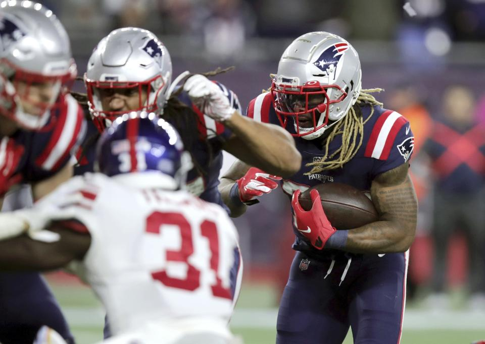New England Patriots running back Brandon Bolden, right, follows his blockers into the end zone for a touchdown against the New York Giants in the first half of an NFL football game, Thursday, Oct. 10, 2019, in Foxborough, Mass. (AP Photo/Charles Krupa)