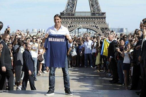 Paris Saint-Germain (PSG) football club's newly recruited Sweden striker Zlatan Ibrahimovic poses with his shirt in front of the Eiffel tower in Paris. Ibrahimovic greeted fans of his new club Paris Saint-Germain in an ostentatious presentation ceremony in front of the Eiffel Tower in Paris on Wednesday