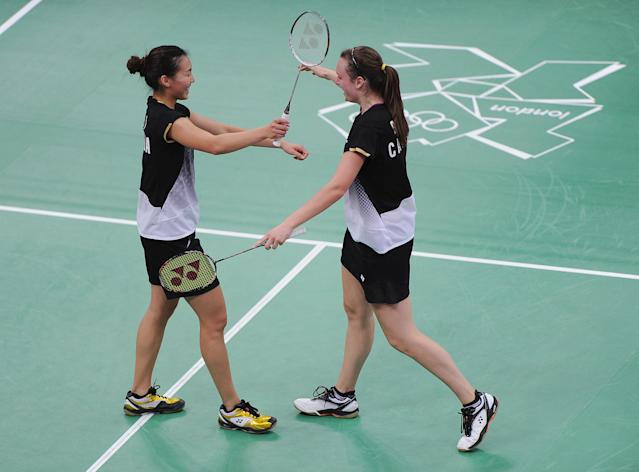 LONDON, ENGLAND - AUGUST 01: Alex Bruce (R) and Michelle Li of Canada celebrate beating Leanne Choo and Renuga Veeran of Australia in their Women's Doubles Badminton on Day 5 of the London 2012 Olympic Games at Wembley Arena at Wembley Arena on August 1, 2012 in London, England. (Photo by Michael Regan/Getty Images)