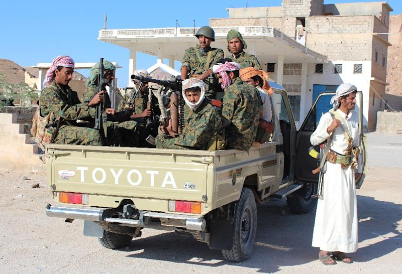 Fighters loyal to Yemen's President Abedrabbo Mansour Hadi patrol in Shabwa province, east of Aden, on December 21, 2015