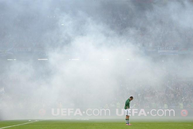 TOPSHOTS  Irish midfielder Aiden McGeady is engulfed in smoke from a flare during the Ireland against Croatia game at the Euro 2012 football championships on June 10, 2012 at the Municipal Stadium in Poznan. AFP PHOTO / FABRICE COFFRINIFABRICE COFFRINI/AFP/GettyImages
