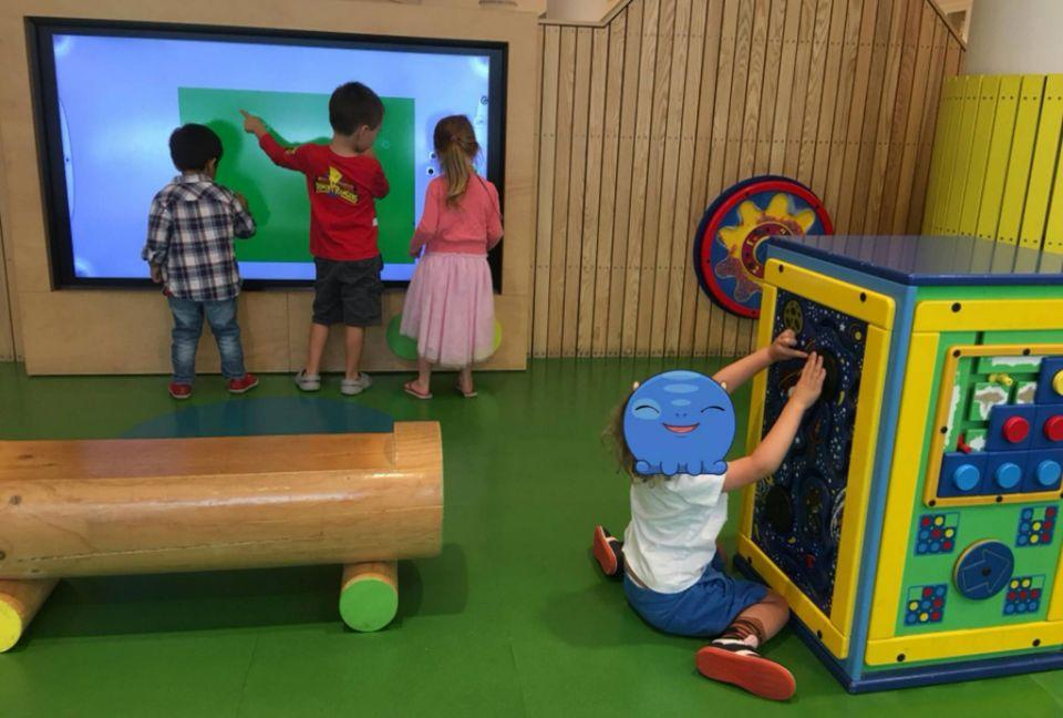 Children stare at a massive screen inside the shopping centre 'play pod'. Source: Facebook