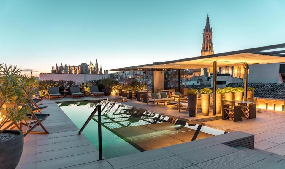 """<p>Situated in the heart of Palma's historic centre, this city hotel in Mallorca offers the perfect base for urbanites to enjoy a sleek break or romantic weekend with practically year-round sunshine. Five-star, boutique hotel <a href=""""https://go.redirectingat.com?id=127X1599956&url=https%3A%2F%2Fwww.booking.com%2Fhotel%2Fes%2Fsant-francesc-singular.en-gb.html%3Faid%3D2070929%26label%3Dmallorca-hotels&sref=https%3A%2F%2Fwww.redonline.co.uk%2Ftravel%2Fg37570714%2Fmallorca-hotels%2F"""" rel=""""nofollow noopener"""" target=""""_blank"""" data-ylk=""""slk:Sant Francesc Hotel Singular"""" class=""""link rapid-noclick-resp"""">Sant Francesc Hotel Singular</a> is set within a former Mallorcan mansion, built in 1860, and home to 42 elegant rooms and suites, three restaurants and bars, and a fitness and wellbeing centre. </p><p>Its stunning roof terrace with an enticing pool is the perfect sunbathing spot, and in the evening you can enjoy sundowners at the rooftop bar with panoramic views across the city. The hotel's spa is an oasis in the heart of Palma's old town, offering a treatment menu designed to counteract the effects of urban lifeand using the finest products from Anne Semonin. Around the hotel, there's an exquisite collection of contemporary art and photographs that adorn the walls.</p><p><a class=""""link rapid-noclick-resp"""" href=""""https://go.redirectingat.com?id=127X1599956&url=https%3A%2F%2Fwww.booking.com%2Fhotel%2Fes%2Fsant-francesc-singular.en-gb.html%3Faid%3D2070929%26label%3Dmallorca-hotels&sref=https%3A%2F%2Fwww.redonline.co.uk%2Ftravel%2Fg37570714%2Fmallorca-hotels%2F"""" rel=""""nofollow noopener"""" target=""""_blank"""" data-ylk=""""slk:CHECK AVAILABILITY"""">CHECK AVAILABILITY</a></p>"""