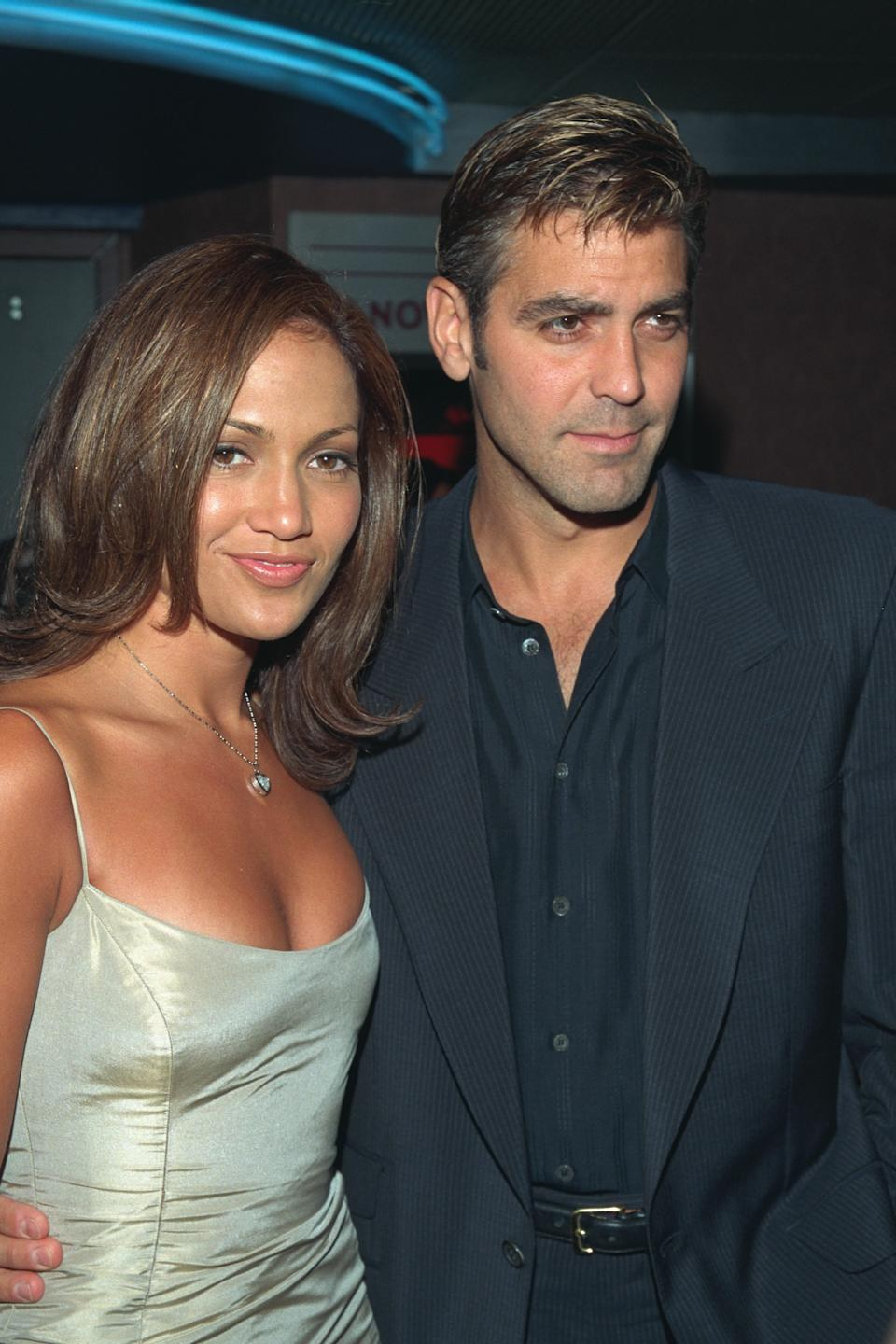 (Original Caption) George Clooney and Jennifer Lopez, stars of the movie at the Chelsea West Cinema. (Photo by Steve Azzara/Corbis via Getty Images)