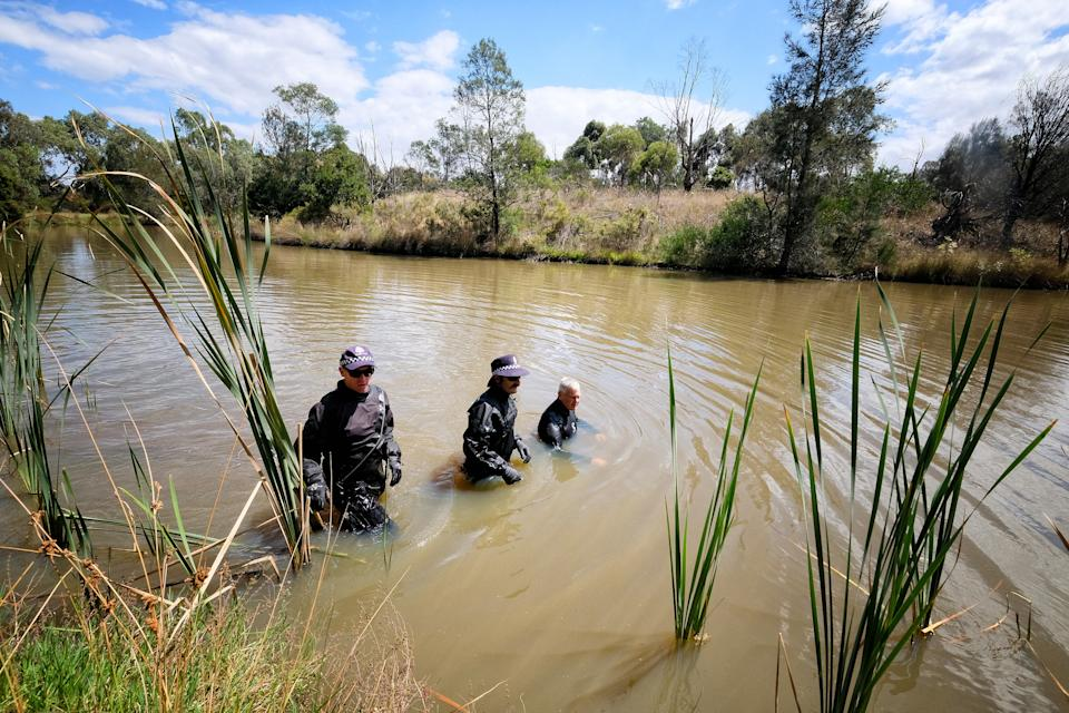 Police officers searching for Kelly 'Ju' Zhang in waters in Heidelberg West on February 22, 2021.