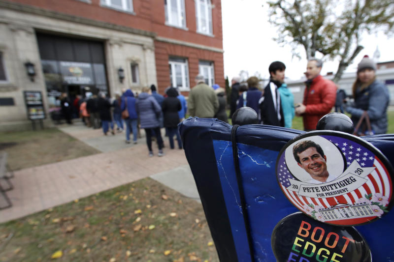 Campaign buttons are displayed as people wait outside the Rochester Opera House to hear Democratic presidential candidate South Bend, Ind. Mayor Pete Buttigieg deliver a Veterans Day address, Monday, Nov. 11, 2019, in Rochester, N.H. (AP Photo/Elise Amendola)