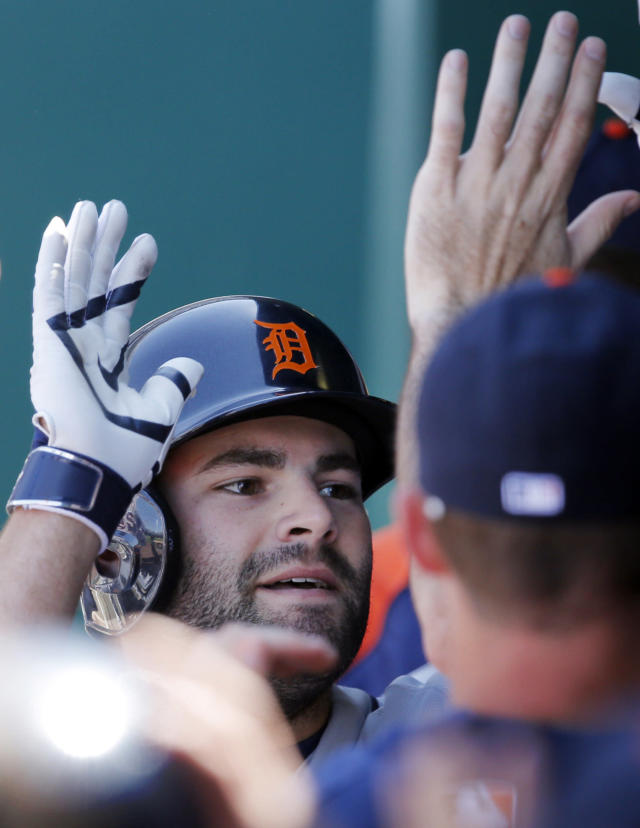 Detroit Tigers catcher Alex Avila is congratulated by teammate following his two-run home run off Kansas City Royals starting pitcher Jason Vargas during the fifth inning of a baseball game at Kauffman Stadium in Kansas City, Mo., Sunday, May 4, 2014. (AP Photo/Orlin Wagner)
