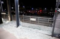 Broken glass is seen at the Bright Castle Motors building after reports of mortar shells landing near Erbil airport