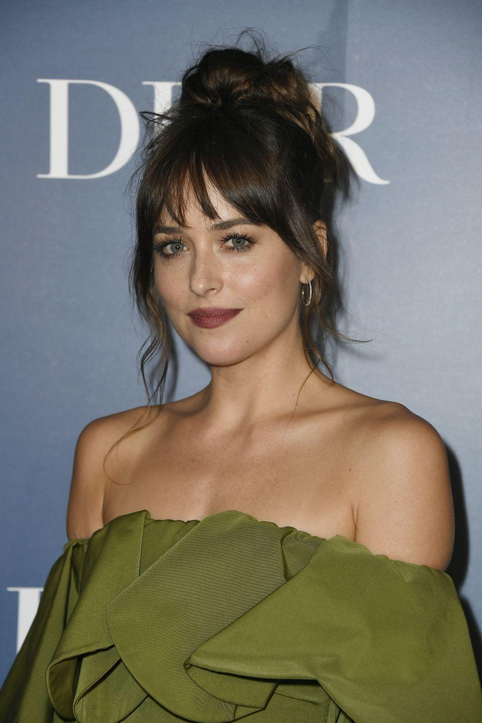 <p>Evening looks can benefit from the trend too, as the Patron Saint of Wispy Bangs, Dakota Johnson, proves here. </p>