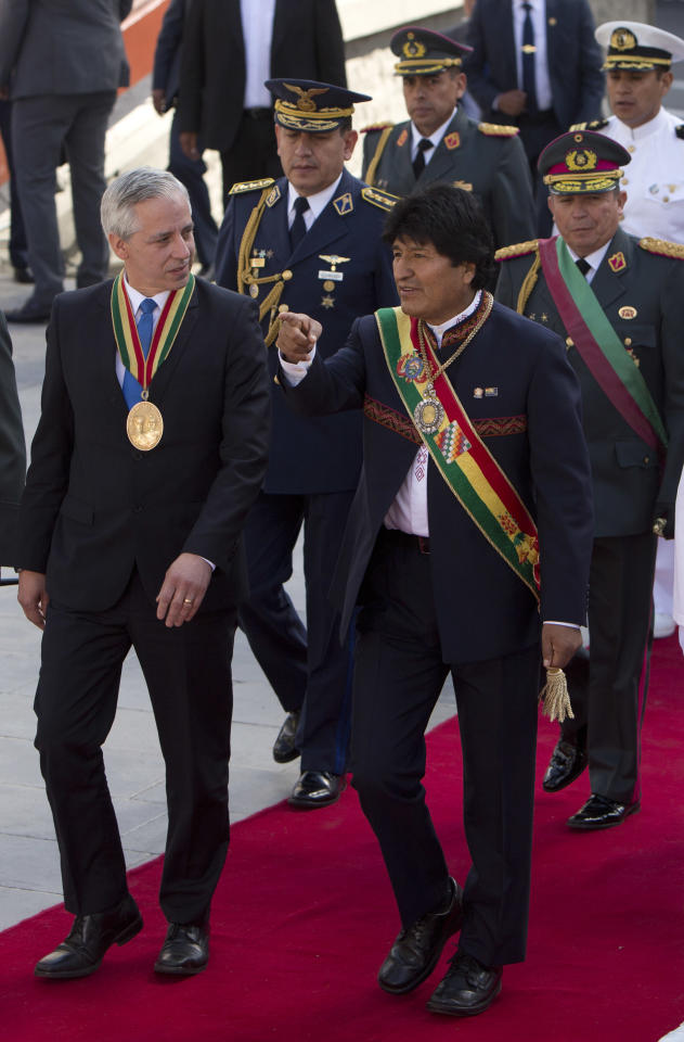 Bolivia's President Evo Morales, right, and his Vice President Alvaro Garcia Linera, arrive for an event honoring national hero Eduardo Abaroa, who died in the 1879-1884 War of the Pacific, during Sea Day commemorations in La Paz, Bolivia, Friday, March 23, 2018. Sea Day marks the anniversary of Bolivia losing a 19th century war against Chile, with the subsequent loss of its Pacific coastline. The International Court of Justice in The Hague is holding public hearings in the case concerning the obligation to negotiate access to the Pacific Ocean between both countries. (AP Photo/Juan Karita)