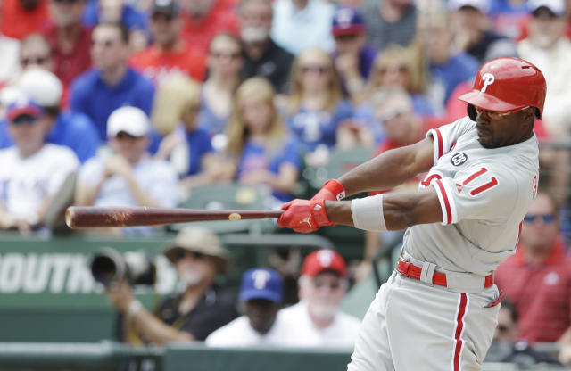 Philadelphia Phillies' Jimmy Rollins hits a grand slam home run against the Texas Rangers during the second inning of an opening day baseball game at Globe Life Park, Monday, March 31, 2014, in Arlington, Texas. (AP Photo/Kim Johnson Flodin)