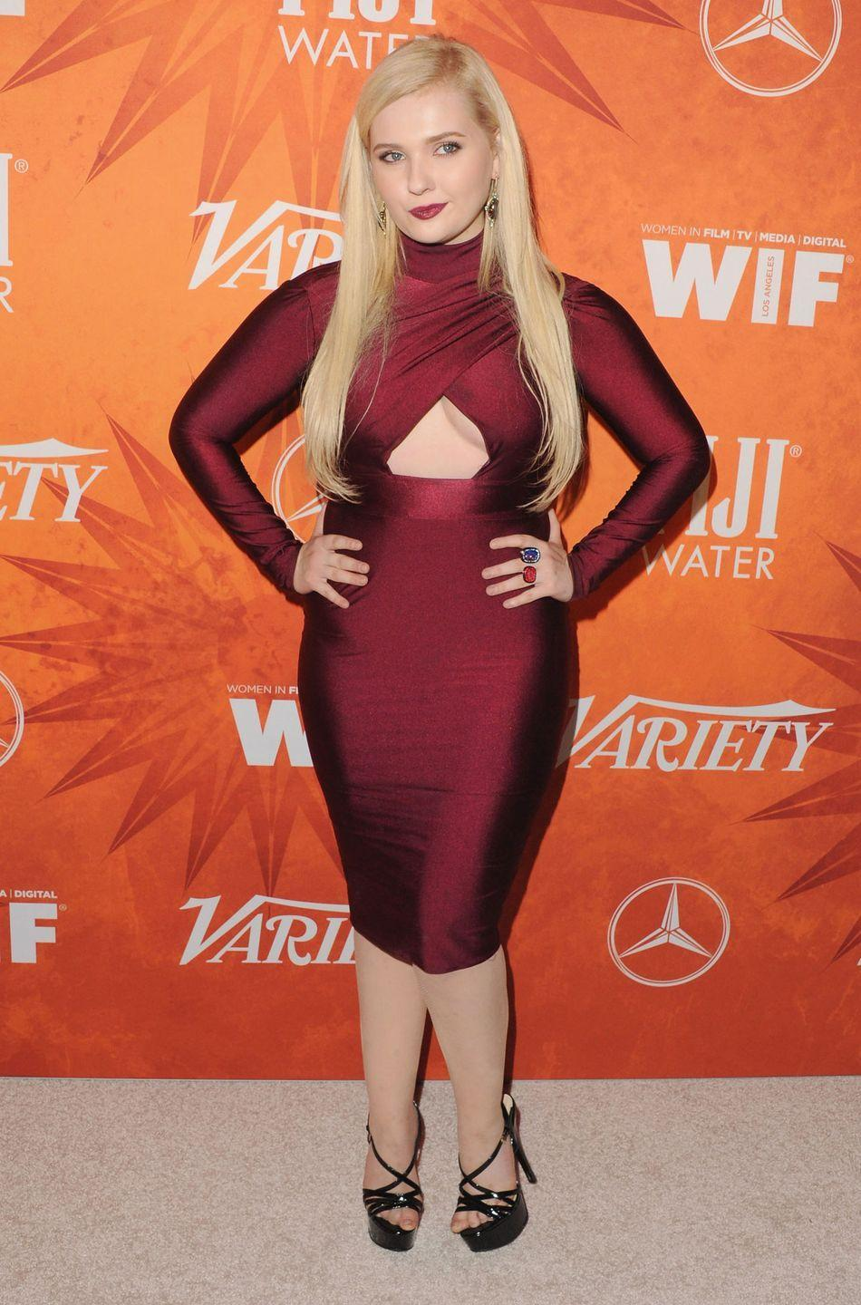 "<p>The 23-year-old actress ain't so little anymore — she's <a href=""https://www.goodhousekeeping.com/life/entertainment/a34523/abigail-breslin-emmys-red-carpet/"" rel=""nofollow noopener"" target=""_blank"" data-ylk=""slk:shed the quirky track suit and glasses"" class=""link rapid-noclick-resp"">shed the quirky track suit and glasses</a>, and she starred in Ryan Murphy's campy TV series, <em>Scream Queens</em>.</p>"