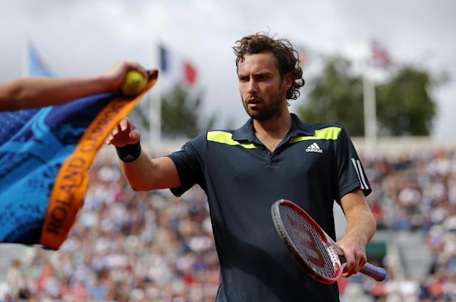 Latvia's Ernests Gulbis takes his towel as he plays Tomas Berdych of the Czech Republic during their quarterfinal match of the French Open tennis tournament at the Roland Garros stadium, in Paris, France, Tuesday, June 3, 2014. Gulbis won 6-3, 6-2, 6-4. (AP Photo/David Vincent)