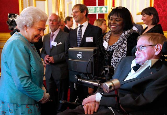 <p>Britain's Queen Elizabeth (L) meets Stephen Hawking during a reception for Leonard Cheshire Disability charity at St James's Palace in London, May 29, 2014. (Photo: Jonathan Brady/Pool/Reuters) </p>