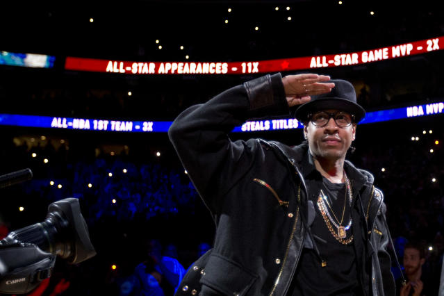Former Philadelphia 76er Allen Iverson salutes the crowd during a retirement ceremony at halftime of an NBA basketball game between the 76ers and the Washington Wizards, Saturday, March 1, 2014, in Philadelphia. (AP Photo/Matt Slocum)