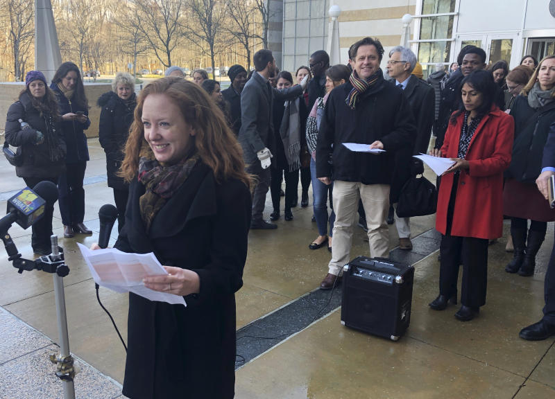 FILE - In this Wednesday, Jan. 8, 2020, file photo, Linda Evarts, an attorney for the International Refugee Assistant Project, speaks to the media outside the federal courthouse in Greenbelt, Md. A federal judge agreed Wednesday, Jan. 15, 2020, to block the Trump administration from enforcing an executive order allowing state and local government officials to reject refugees from resettling in their jurisdictions. U.S. District Judge Peter Messitte in Maryland issued a preliminary injunction requested by three national refugee resettlement agencies that sued to challenge the executive order. (AP Photo/Michael Kunzelman, File)