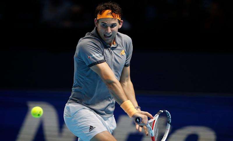 Dominic Thiem plays a backhand against Novak Djokovic during their match at the ATP Finals 2019. AP