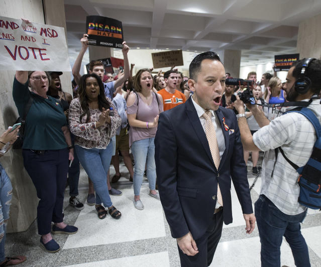 <p>Florida Rep. Carlos Guillermo Smith, leads students as they chant protest slogans outside the House of Representative chamber inside the Florida Capitol in Tallahassee, Fla., Feb 21, 2018. (Photo: Mark Wallheiser/AP) </p>