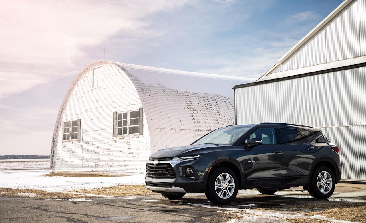 """<p>Chevrolet resurrects the Blazer nameplate for 2019, but this all-new crossover prioritizes style over the ruggedness of its legendary off-road predecessors. The two-row Blazer is positioned between <a href=""""https://www.caranddriver.com/chevrolet/equinox"""">the compact Chevy Equinox </a>and <a href=""""https://www.caranddriver.com/chevrolet/traverse"""">the three-row Chevy Traverse</a>. Its mid-size classification pits it head to head against other two-row rivals such as <a href=""""https://www.caranddriver.com/ford/edge"""">the Ford Edge</a> and <a href=""""https://www.caranddriver.com/honda/passport"""">the Honda Passport</a>. While the Blazer is available with a potent 308-hp V-6 engine and all-wheel drive, entry-level models such as the one we tested for this review are available only with front-wheel drive and a dutiful 193-hp four-cylinder. We'll detail much of the content and capabilities that make this Blazer so budget friendly.</p>"""