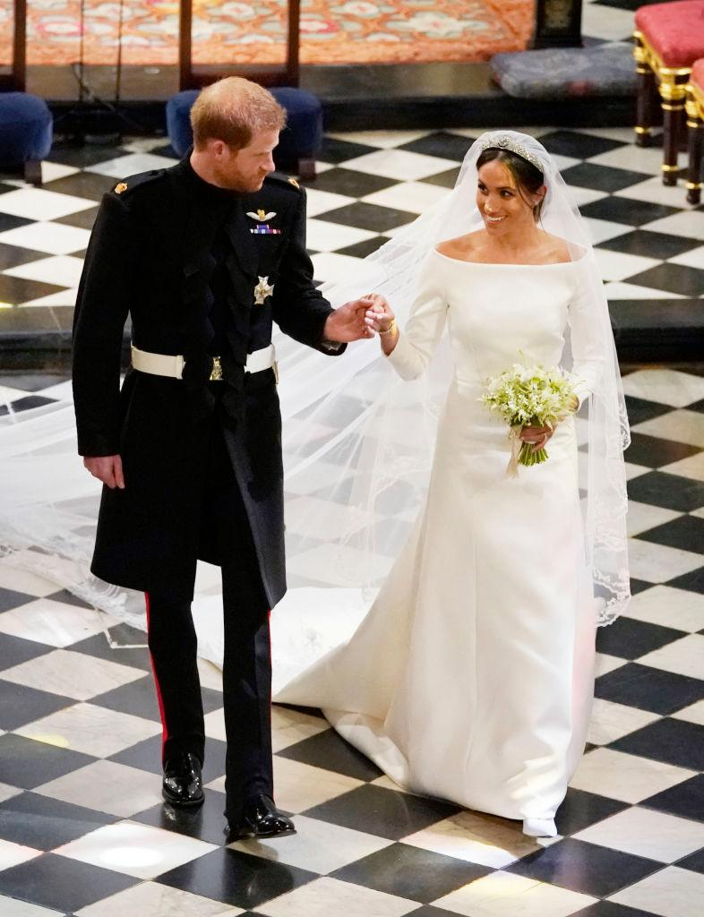 <p>The Duchess of Sussex's minimalist boatneck gown and embroidered veil became wedding inspiration for brides around the world. <em>(Image via Getty Images)</em></p>