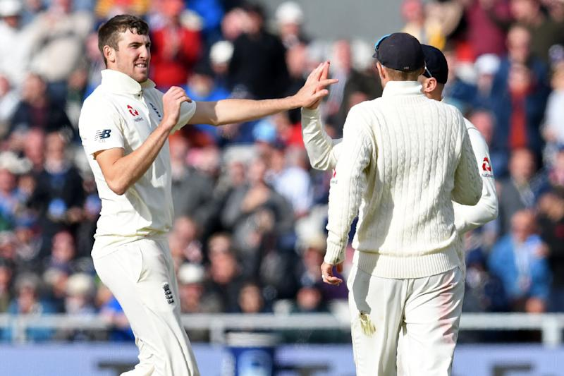 England's Craig Overton (L) celebrates with teammates after taking the wicket of Australia's captain Tim Paine during play on the second day of the fourth Ashes cricket Test match between England and Australia at Old Trafford in Manchester, north-west England on September 5, 2019. (Photo by Paul ELLIS / AFP) / RESTRICTED TO EDITORIAL USE. NO ASSOCIATION WITH DIRECT COMPETITOR OF SPONSOR, PARTNER, OR SUPPLIER OF THE ECB (Photo credit should read PAUL ELLIS/AFP/Getty Images)