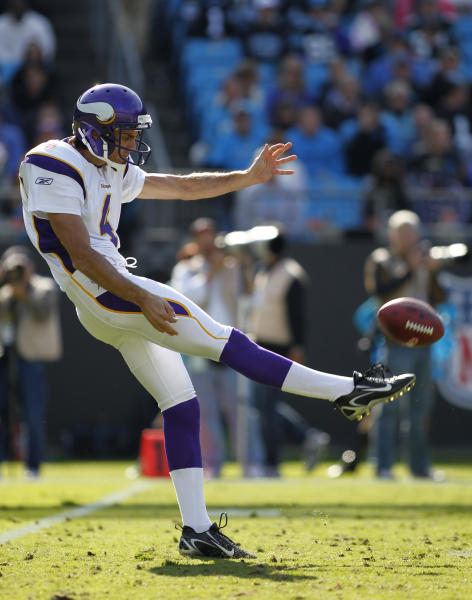 In this Oct. 30, 2011, photo, Minnesota Vikings' Chris Kluwe punts to the Carolina Panthers during an NFL football game in Charlotte, N.C. Kluwe, who is no longer with the Vikings, says the team's special teams coordinator, Mike Priefer, made anti-gay comments while Kluwe was with the team. (AP Photo/Bob Leverone)
