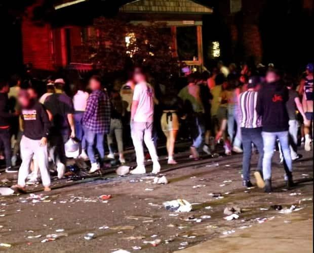 Kingston police say this massive party on Aberdeen Street over the weekend led to charges against three Queen's University students. (Submitted by Kingston police - image credit)