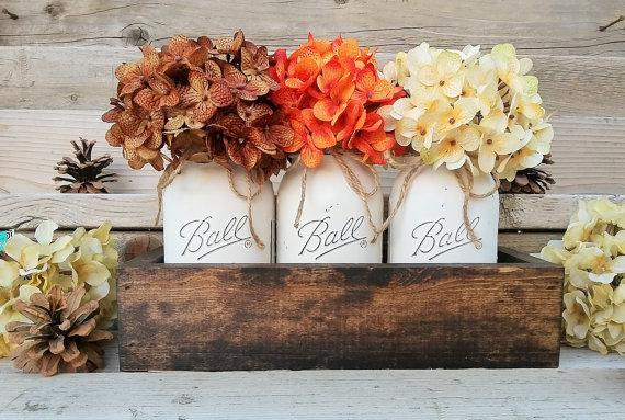 """Add a touch of country living to your uban space with<a href=""""https://www.etsy.com/listing/252148601/fall-table-centerpiecefall?ga_order=most_relevant&ga_search_type=all&ga_view_type=gallery&ga_search_query=thanksgiving%20table%20decor&ref=sr_gallery_20"""" target=""""_blank"""">mason jar centerpieces</a>."""