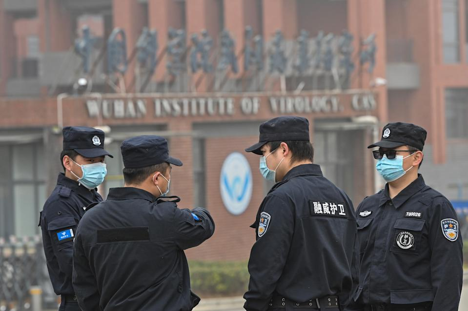 <p>Security personnel stand guard outside the Wuhan Institute of Virology in Wuhan as members of the World Health Organization (WHO) team investigating the origins of the COVID-19 coronavirus make a visit</p> (AFP via Getty Images)
