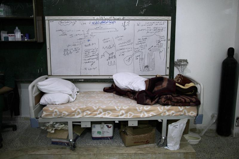 In this Tuesday, Dec. 18, 2012 photo, the bed of a Syrian patient, not pictured, at an intensive care unit of a hospital is seen in the village of Atmeh, Syria. (AP Photo/Muhammed Muheisen)