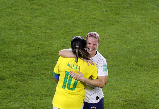 France's Eugenie Le Sommer, right, hugs Brazil's Marta at the end of the Women's World Cup round of 16 soccer match between France and Brazil at Stade Oceane, in Le Havre, France, Sunday, June 23, 2019. (AP Photo/Francois Mori)