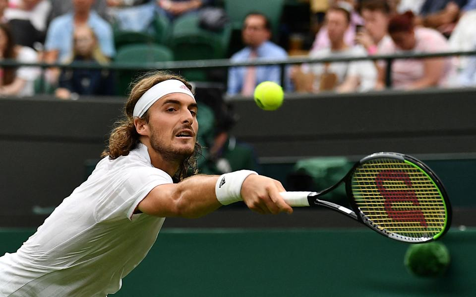 Stefanos Tstistipas crashed out in the first round at Wimbledon again (AFP via Getty Images)
