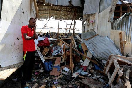 A Somali trader stands outside his shop destroyed near the scene of a suicide bomb explosion at the Wadajir market in Madina district of Somalia's capital Mogadishu February 19, 2017. REUTERS/Feisal Omar