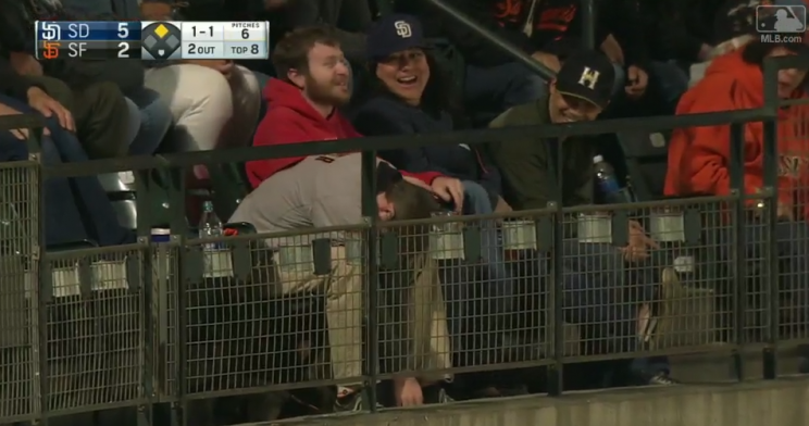 This Giants fan was pretty sad after a foul ball bounced out of his arms. (MLB.com)