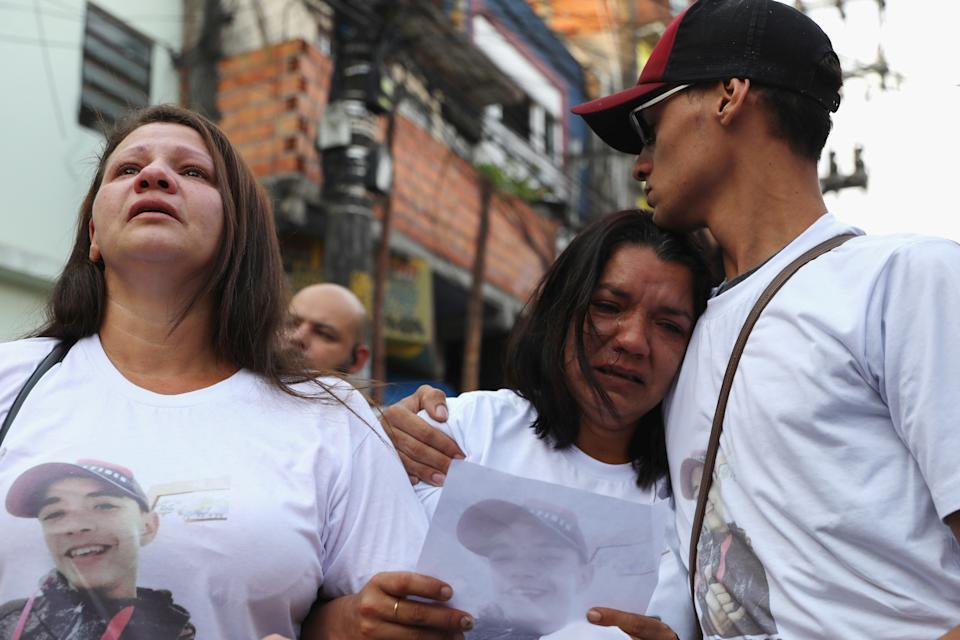 Parents of Denys Henrique Quirino da Silva cry during a protest at Paraisopolis slum after nine people died following a police raid at a Funk Party in Sao Paulo, Brazil December 4, 2019. REUTERS/Amanda Perobelli