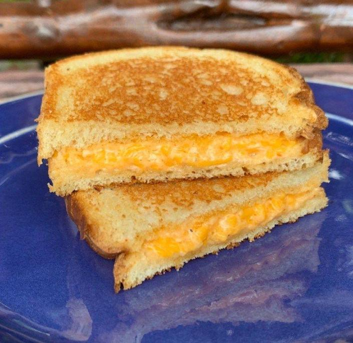"""<p><strong>Pimento Cheese Sandwich</strong><br><br>A local staple to southern states is pimento cheese -- a spread or relish combining shredded cheese, pimentos and mayonnaise. Georgia offers many variations on this lunchbox classic, many of which you can find on <a href=""""https://buttermilkkitchen.com/"""" rel=""""nofollow noopener"""" target=""""_blank"""" data-ylk=""""slk:Buttermilk Kitchen"""" class=""""link rapid-noclick-resp"""">Buttermilk Kitchen</a>'s menu. This sandwich comes with housemade pickles, red pepper jelly and white toast.</p>"""