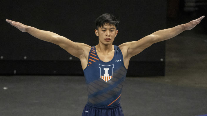 Illinois' Evan Manivong during an NCAA gymnastics meets on Saturday, Feb. 13, 2021, in Iowa City, Iowa. (AP Photo/Justin Hayworth)