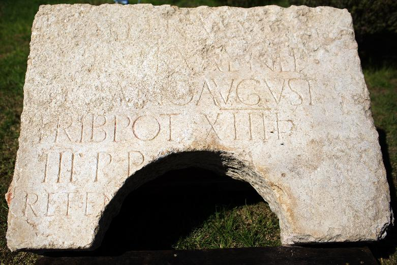 A 2,000-year-old commemorative stone inscription dedicated by the Roman army to Emperor Hadrian, is unveiled at the Rockefeller museum in east Jerusalem, on October 21, 2014 (AFP Photo/Menahem Kahana)