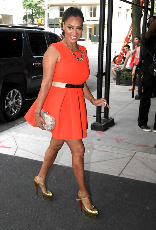 "LaLa Vazquez Anthony is known for her love of designer duds, but while taking meetings in NYC, the reality star sported this affordable Aqua ""Floyd"" dress, which retails for under $200. There's no doubt her gold platform Louboutins cost at least three times that amount! (8/17/2012) Follow omg! on Twitter!"