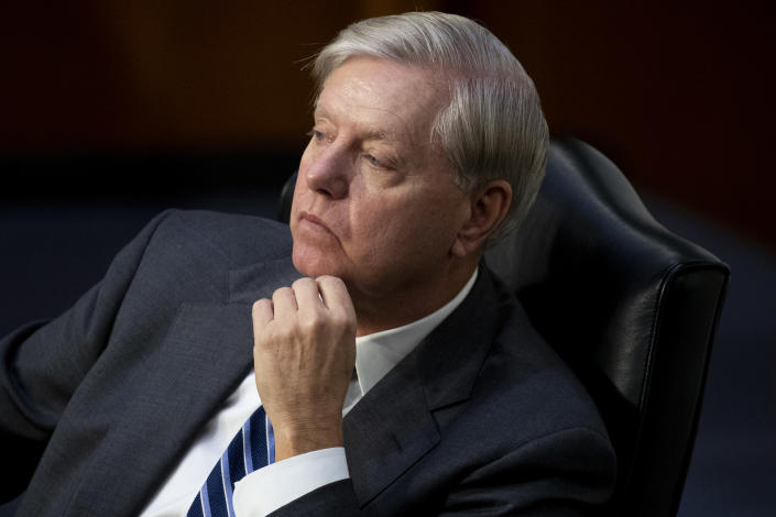 Sen. Lindsey Graham, R-S.C., listens during a confirmation hearing for Supreme Court nominee Amy Coney Barrett before the Senate Judiciary Committee, Wednesday, Oct. 14, 2020, on Capitol Hill in Washington. (Michael Reynolds/Pool via AP)