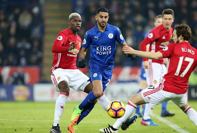 <p>Riyad Mahrez of Leicester City in action with Paul Pogba and Daly Blind of Manchester United during the Premier League match between Leicester City and Manchester United at King Power Stadium on February 05 , 2017 in Leicester, United Kingdom. </p>
