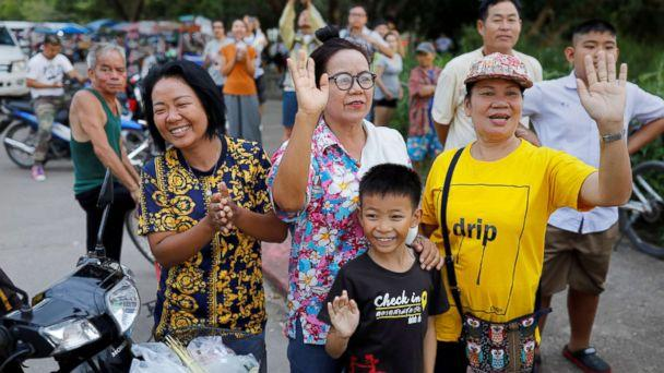 PHOTO: Onlookers wave as an ambulance carrying rescued schoolboys leaves a military airport in Chiang Rai, Thailand, July 10, 2018. (Tyrone Siu/Reuters)