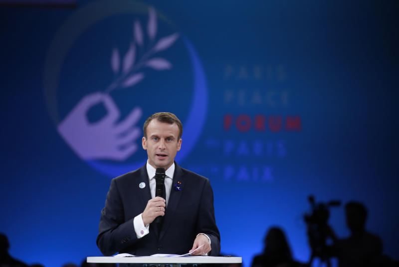French President Emmanuel Macron speaks at the Paris Peace Forum as part of the commemoration ceremony for Armistice Day, in Paris, Sunday, Nov. 11, 2018. International leaders attended a ceremony in Paris on Sunday at mark the 100th anniversary of the end of World War I. (Gonzalo Fuentes, Pool via AP)