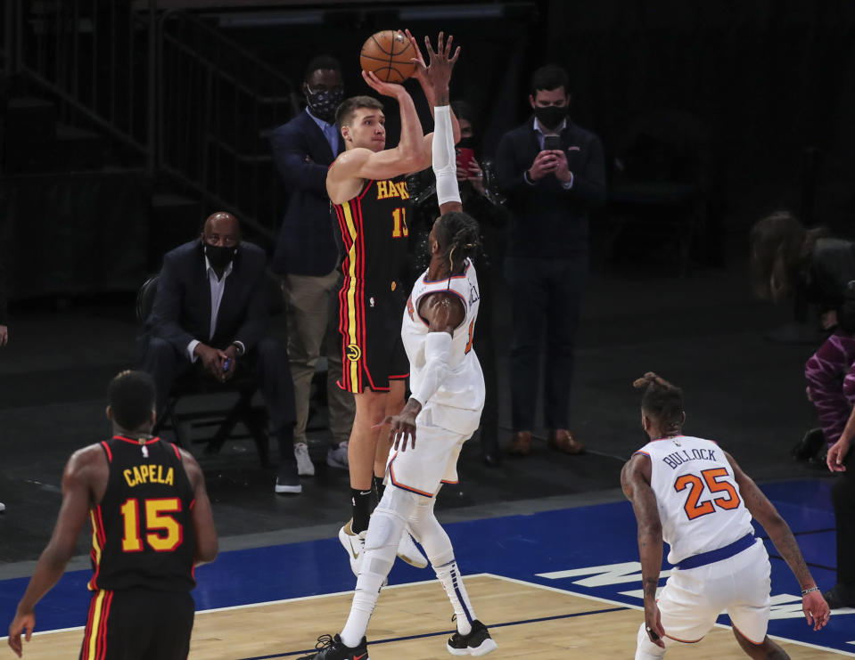 Atlanta Hawks guard Bogdan Bogdanovic (13) makes a 3-point shot against the New York Knicks to tie the score during the fourth quarter of an NBA basketball game Wednesday, April 21, 2021, in New York. (Wendell Cruz/Pool Photo via AP)
