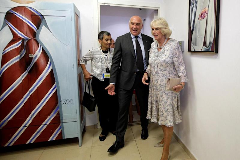 Maurizio Marinella and Camilla Duchess of Cornwall tour his tie laboratory in downtown Naples (REUTERS)