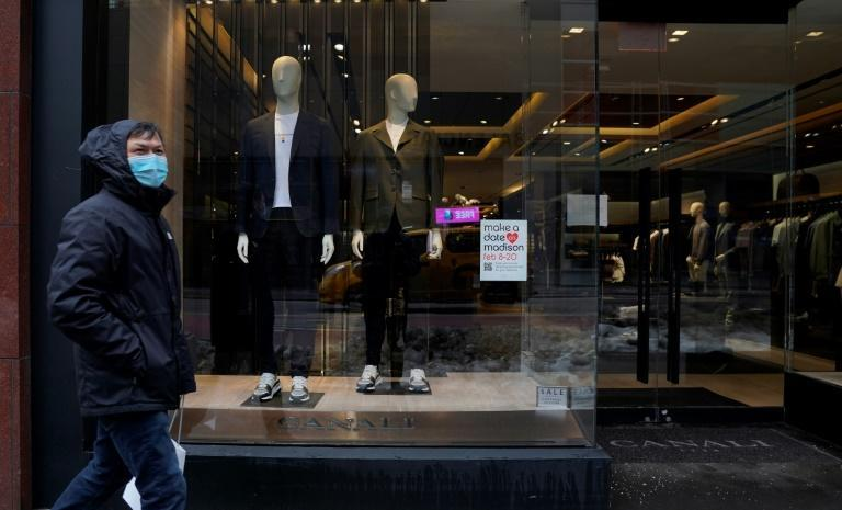A man walks past a store displaying casual men's attire on Madison Avenue in New York on 15 February 2021