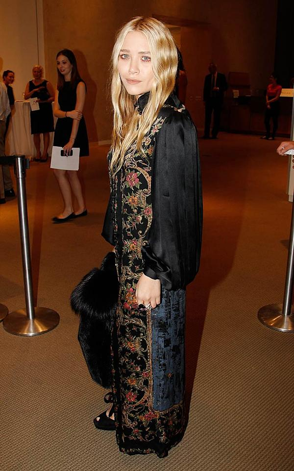 Mary-Kate Olsen may be a hip fashion designer, but she looked drab-tastic in this floor-length kimono style dress. (10/17/2011)