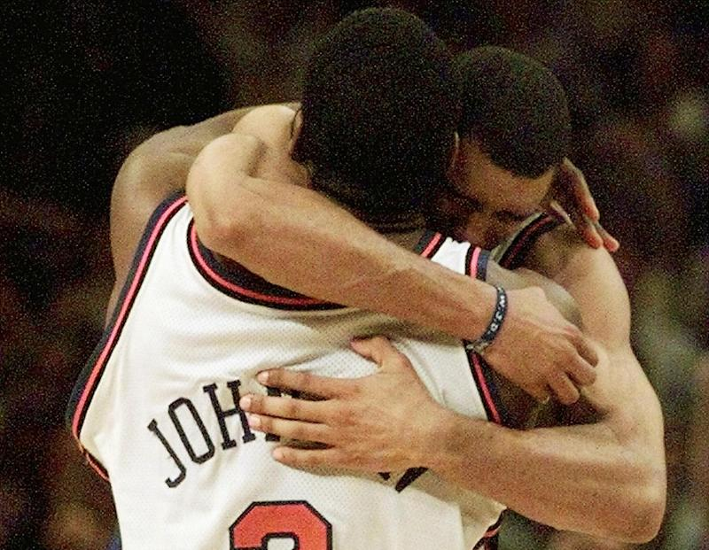 Knicks forward Larry Johnson hugs teammate Allan Houston after his iconic four-point play. (Jeff Haynes/AFP via Getty Images)